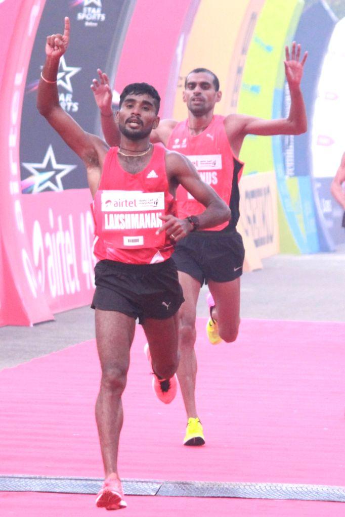Indian athlete G Lakshmanan winner of the Indian men's race in Airtel Delhi Half Marathon 2016 at Jawaharlal Nehru Stadium in New Delhi, on Nov 20, 2016. Also seen Indian athlete Md. Yunus ...