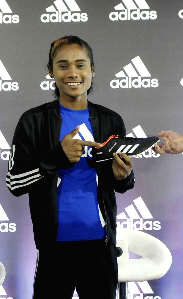Indian athlete Hima Das during a press conference where she signed an endorsement deal with Adidas, in New Delhi, on Sept 18, 2018.