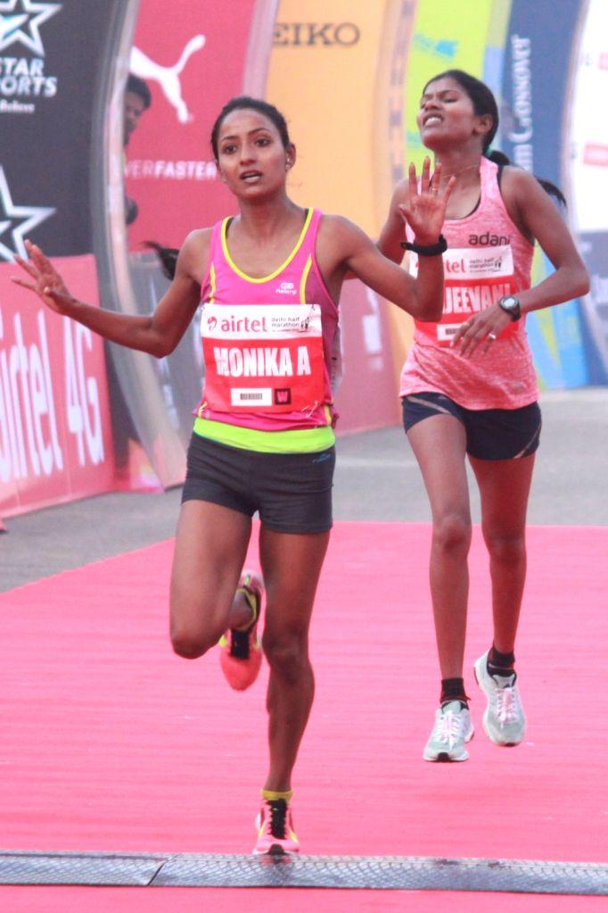 Indian athlete Monika Athare winner of the Indian women's race in Airtel Delhi Half Marathon 2016 at Jawaharlal Nehru Stadium in New Delhi, on Nov 20, 2016. Also seen Indian athlete ...