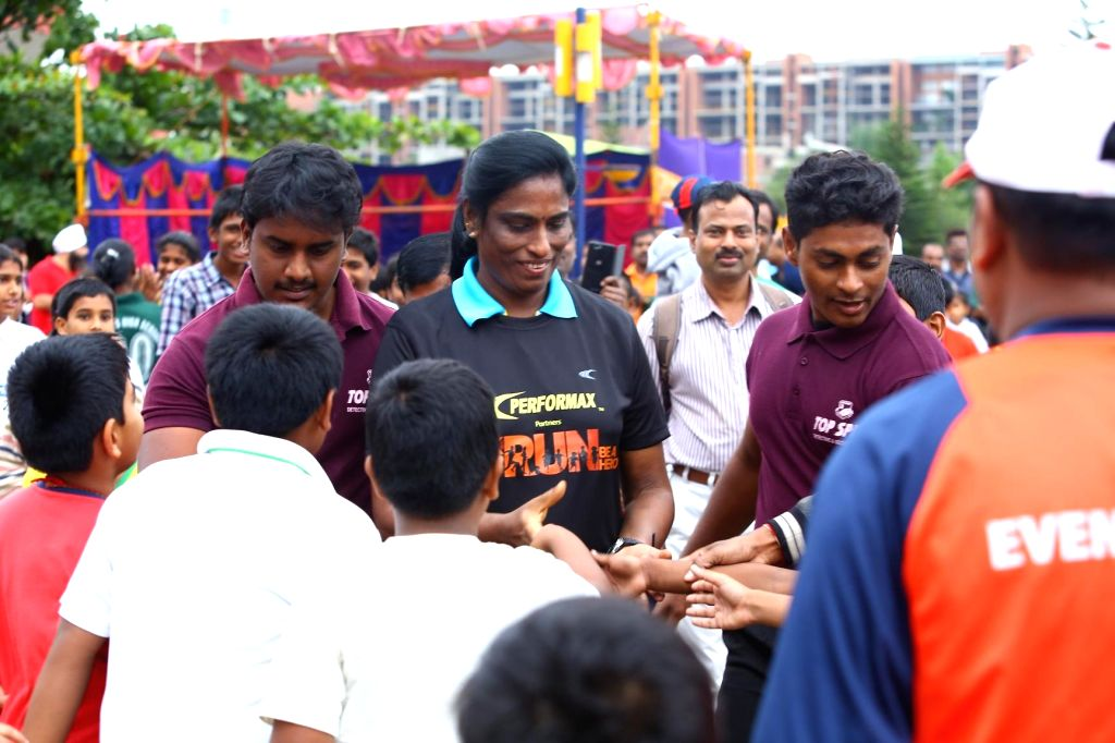 Indian athlete P. T. Usha interacts with runners during GFK Run organised in Bangalore on Sept 8, 2014.
