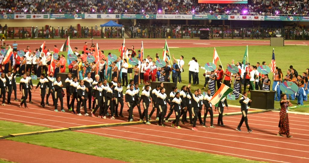 Indian athletes march during the opening ceremony of the 22nd Asian Athletics Championships at Kalinga Stadium, in Bhubaneswar on July 1, 2017.