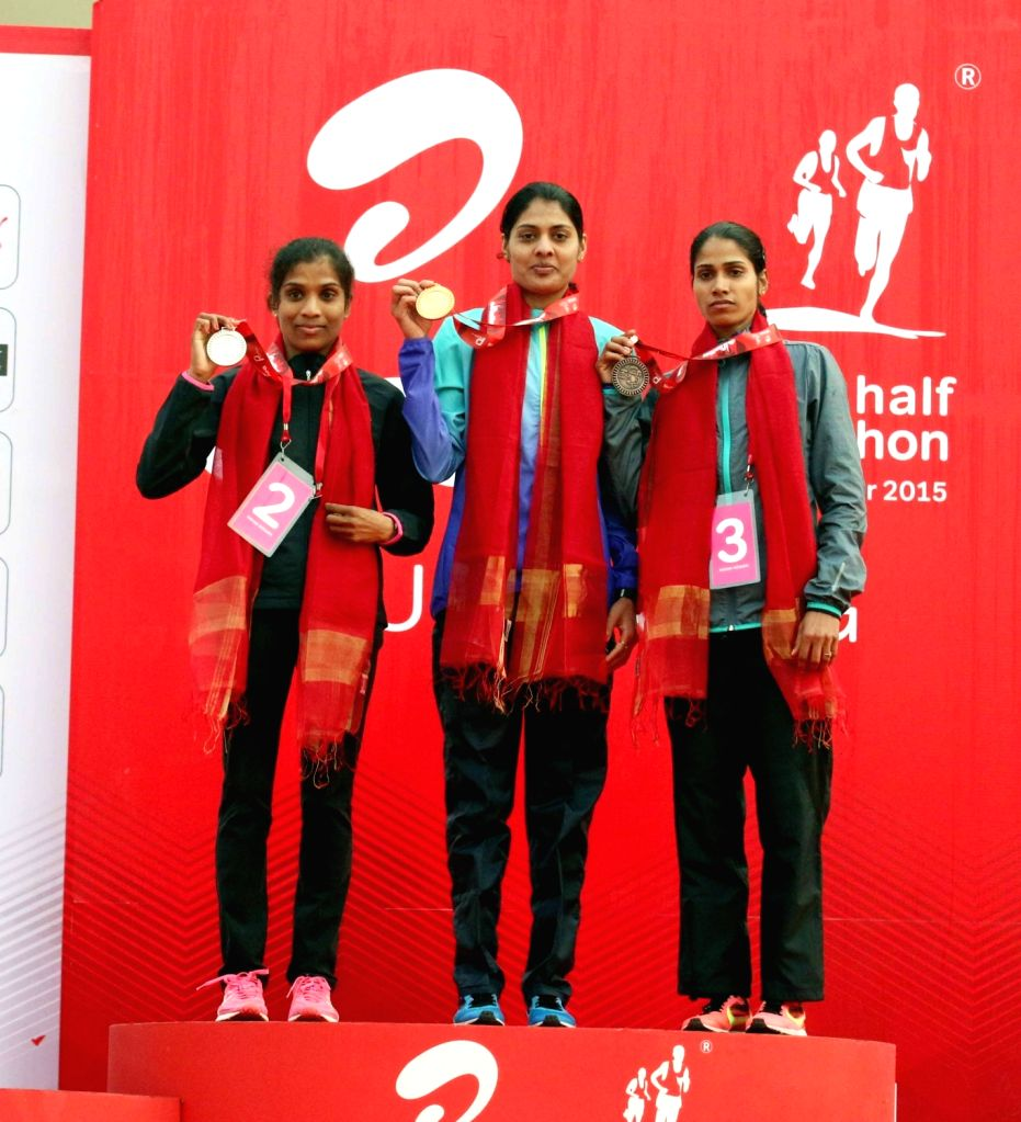 Indian athletes O P Jaisha, Lalita Shivaji Babar and Sudha Singh during the prize distribution ceremony of Indian Elite Women event at the Airtel Delhi Half Marathon, on Nov 29, 2015. - Sudha Singh