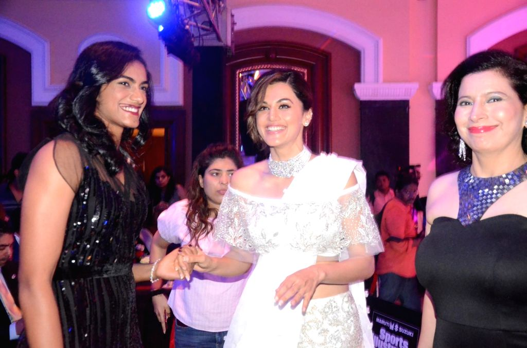 Indian badminton player P.V. Sindhu and actress Taapsee Pannu during Sports Illustrated award ceremony in Mumbai, on July 6, 2017. - Taapsee Pannu