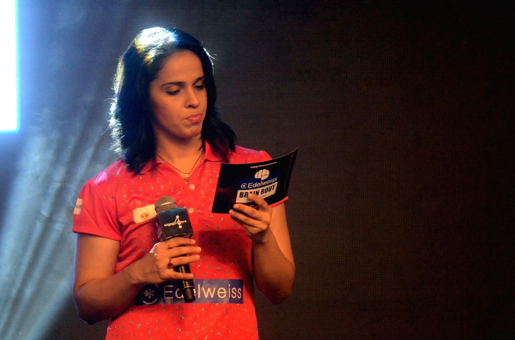 Indian badminton player Saina Nehwal dons the hat of a quiz master at the grand finale of an inter corporate quiz in Mumbai on May 7, 2017.