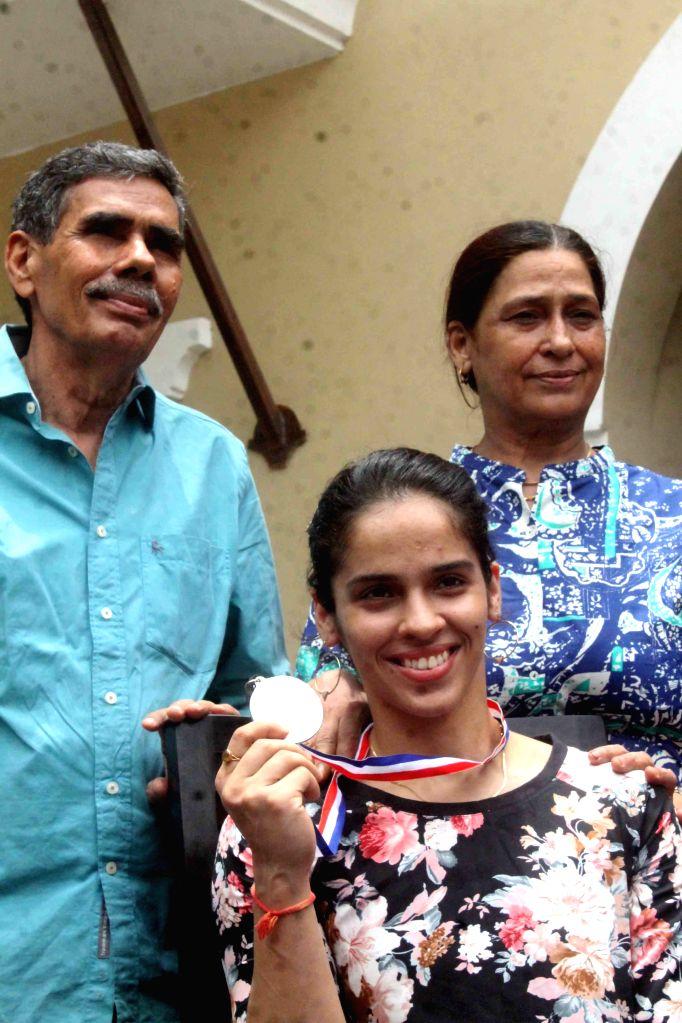 Indian badminton player Saina Nehwal who won silver at the World Championships with her father Harvir Singh Nehwal and mother Usha Nehwal during a press conference in Hyderabad on Aug 18, ... - Harvir Singh Nehwal