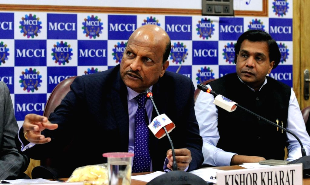 """Indian Bank MD and CEO Kishor Kharat (L) addresses during an interactive session on """"Banks in India and Business Partnerships Challenges and opportunities"""" organised by MCCI in ..."""