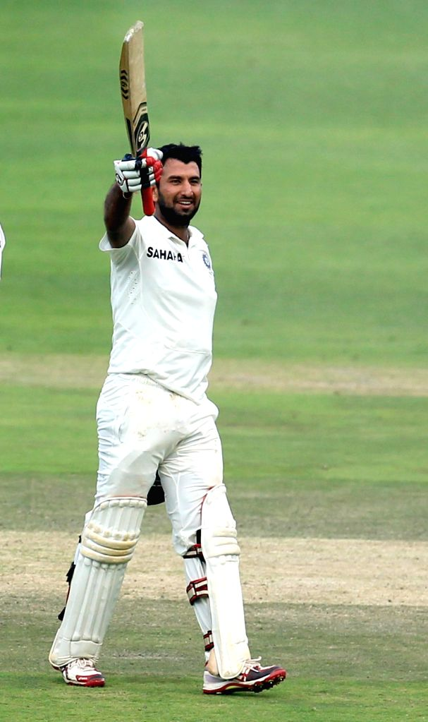 Indian batsman Cheteshwar Pujara celebrates his century during the 3rd Day of the First Test match between India and South Africa played at New Wanderers Stadium in Johannesburg on Dec.20, 2013. - Cheteshwar Pujara