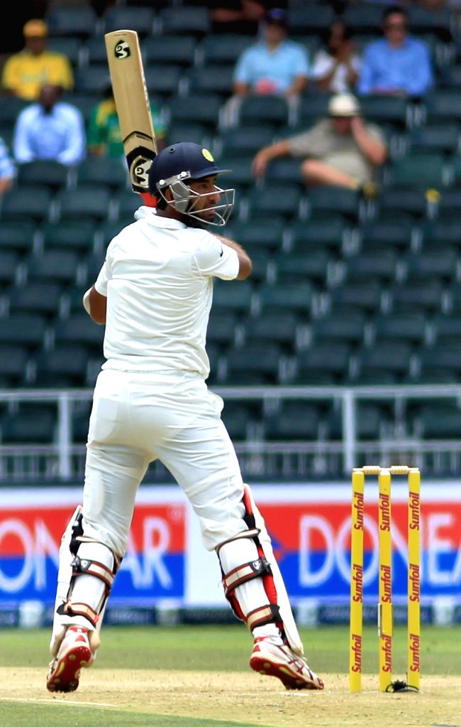 Indian batsman Cheteshwar Pujara in action during the 1st Day of the First Test match between India and South Africa played at New Wanderers Stadium in Johannesburg on Dec.18, 2013. - Cheteshwar Pujara