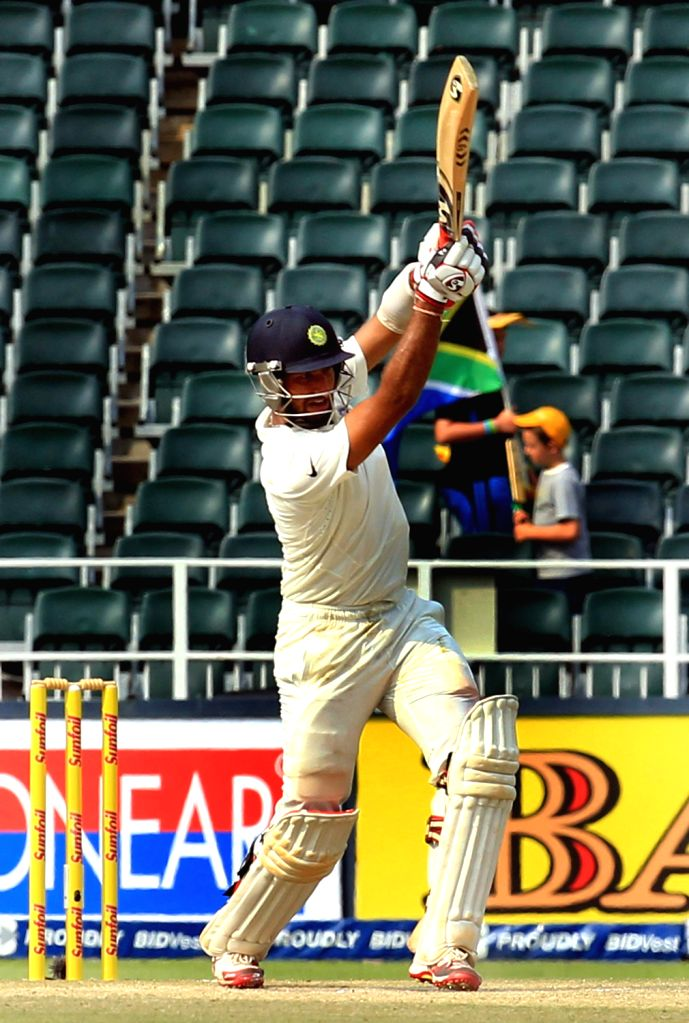 Indian batsman Cheteshwar Pujara in action during the 3rd Day of the First Test match between India and South Africa played at New Wanderers Stadium in Johannesburg on Dec.20, 2013. - Cheteshwar Pujara