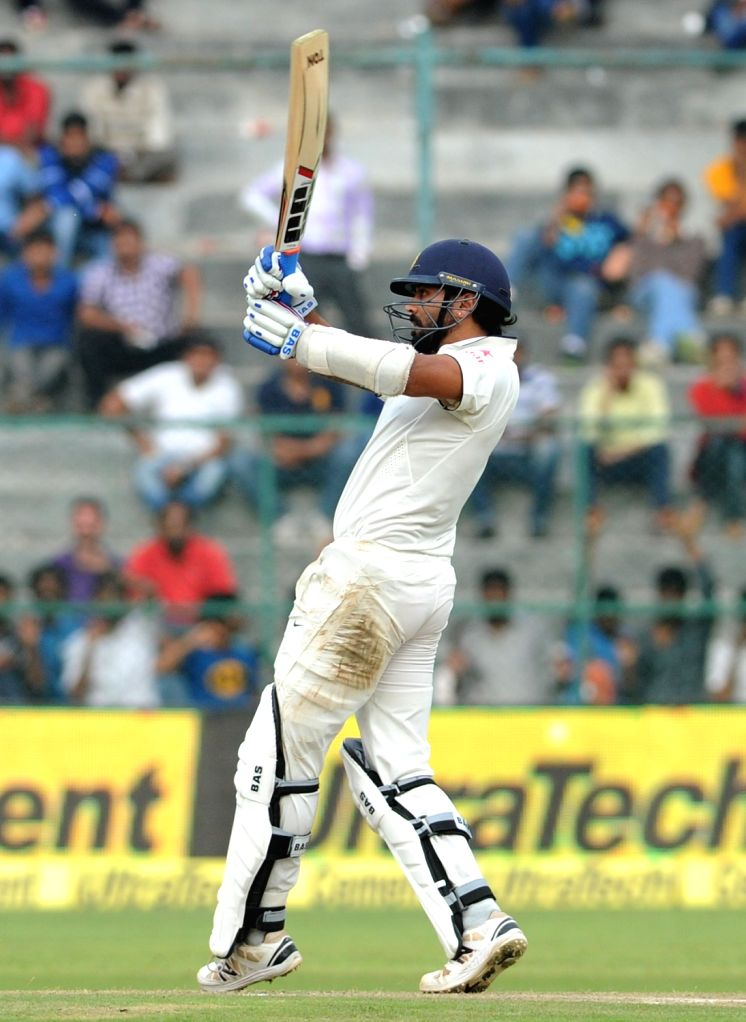 Indian batsman Murali Vijay in action during the first day of the second test match between India and South Africa at M Chinnaswamy Stadium in Bengaluru, on Nov 14, 2015. - Murali Vijay