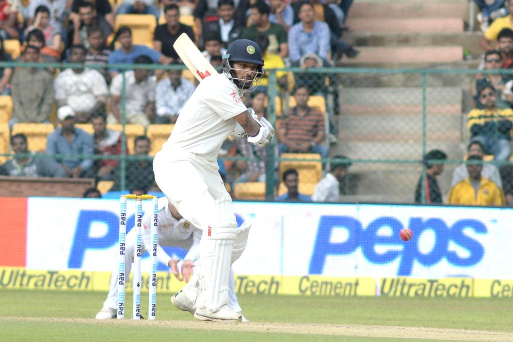 Indian batsman Shikhar Dhawan in action during the first day of the second test match between India and South Africa at M Chinnaswamy Stadium in Bengaluru, on Nov 14, 2015. - Shikhar Dhawan