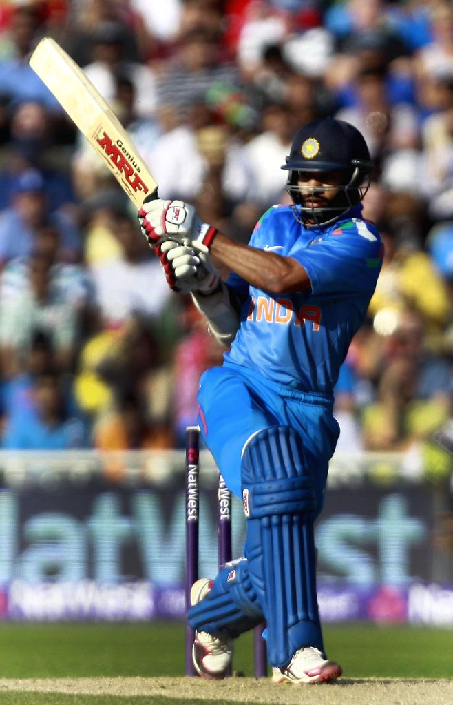 Indian batsman Shikhar Dhawan in action during a T20 match between India and England at Edgbaston, Birmingham, England on Sept 7, 2014. - Shikhar Dhawan