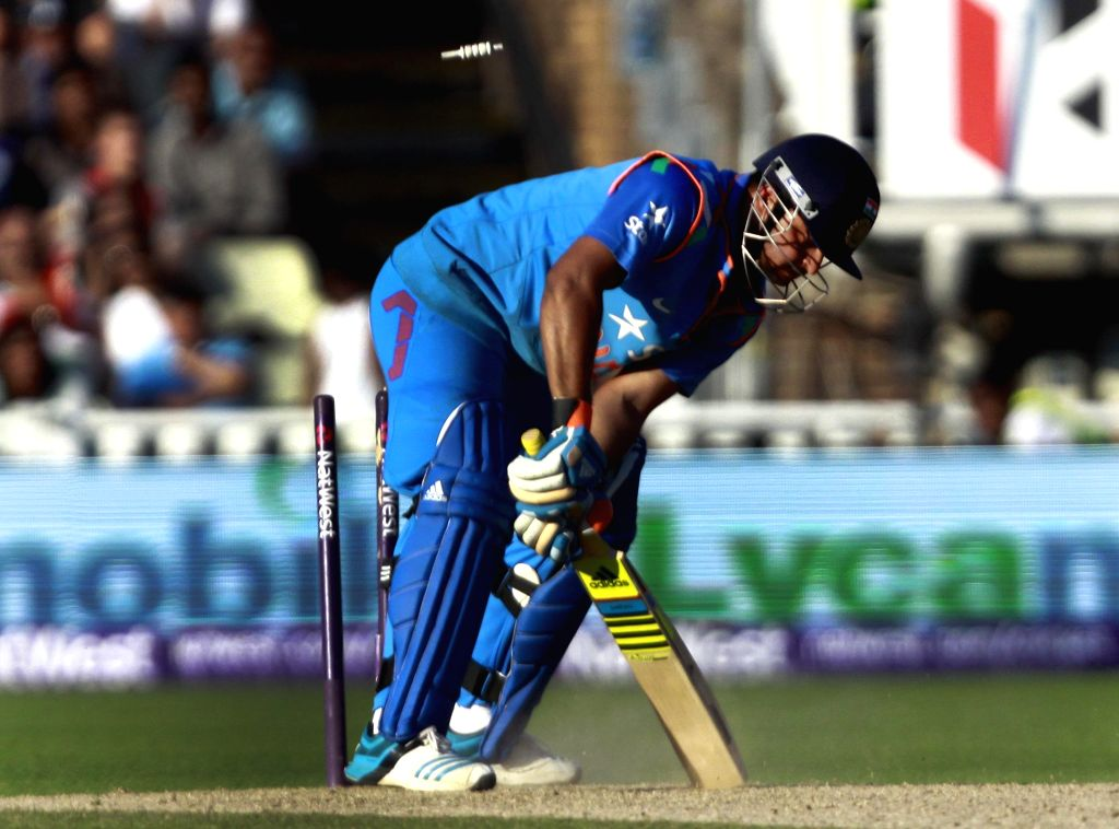 Indian batsman Suresh Raina gets bowled during a T20 match between India and England at Edgbaston, Birmingham, England on Sept 7, 2014. - Suresh Raina
