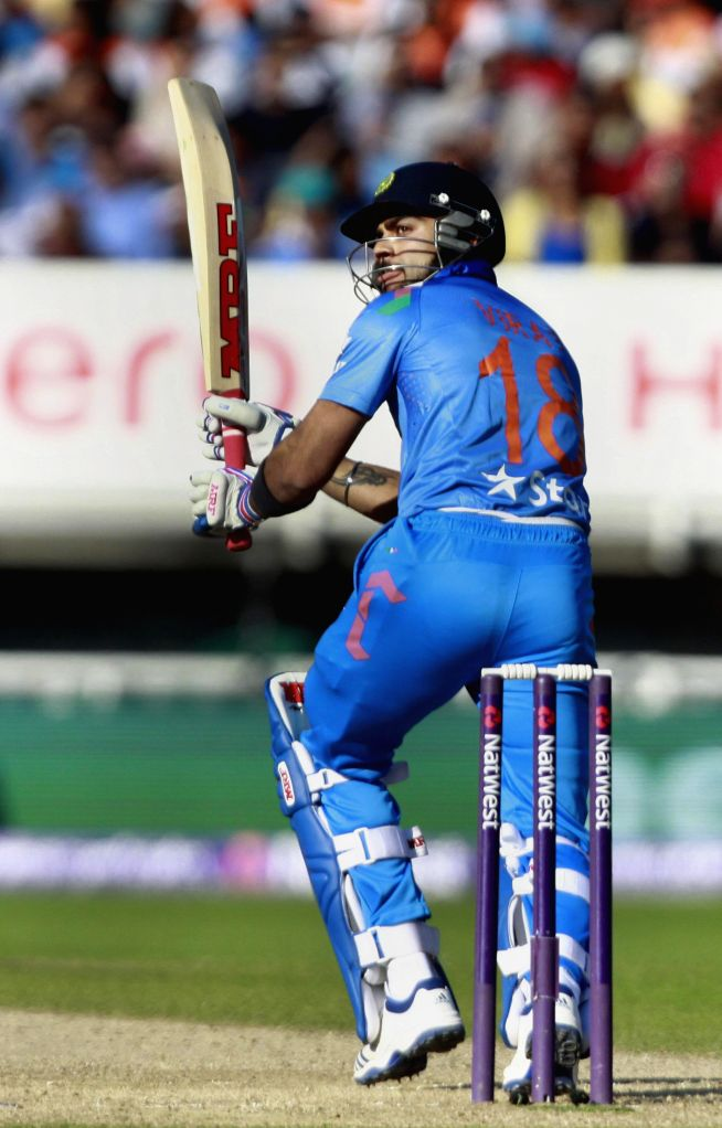 Indian batsman Virat Kohli in action during a T20 match between India and England at Edgbaston, Birmingham, England on Sept 7, 2014. - Virat Kohli