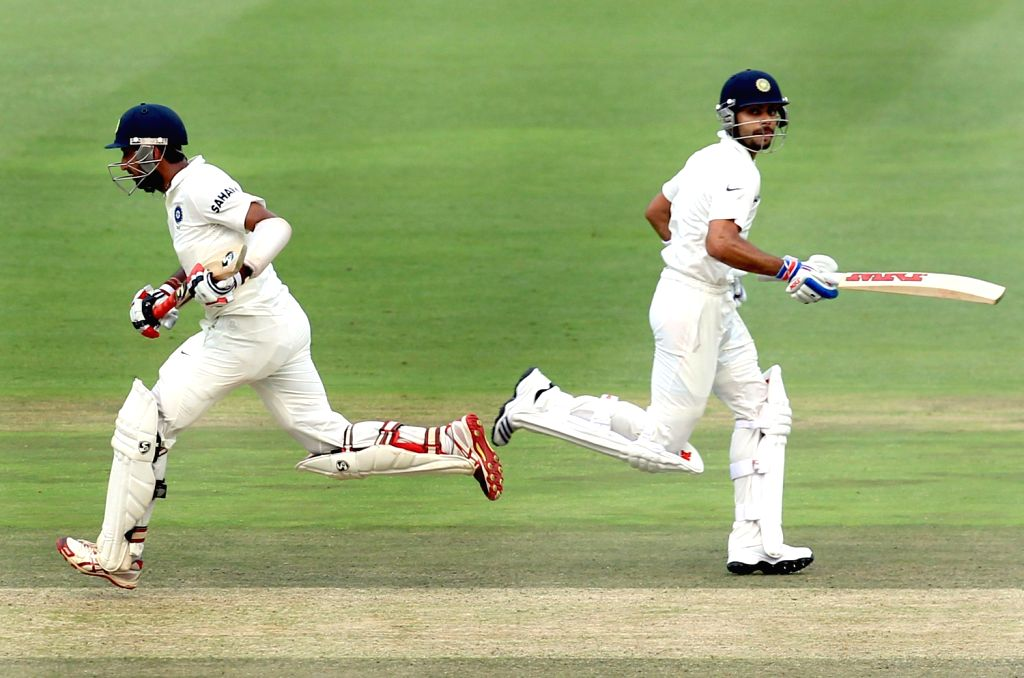 Indian batsmen Cheteshwar Pujara and Virat Kohli fetch a run during the 3rd Day of the First Test match between India and South Africa played at New Wanderers Stadium in Johannesburg on Dec.20, 2013. - Virat Kohli