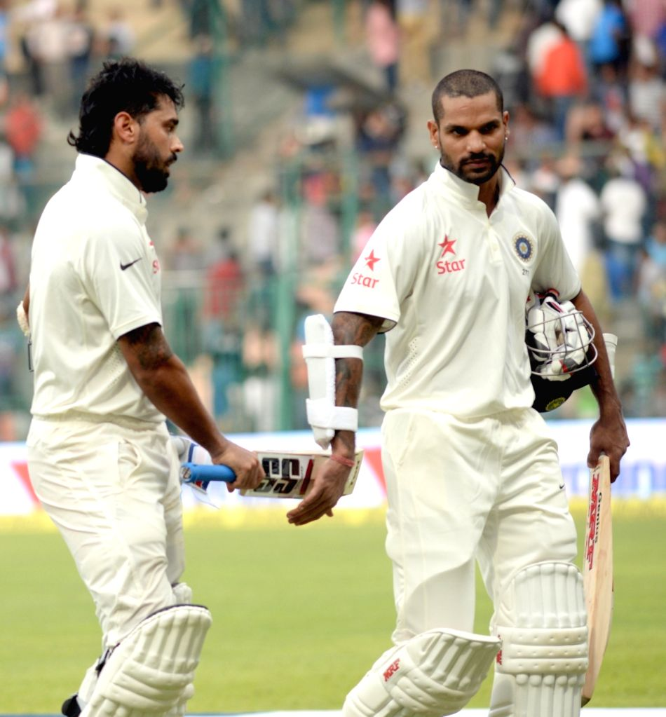 Indian batsmen Murali Vijay and Shikhar Dhawan during the first day of the second test match between India and South Africa at M Chinnaswamy Stadium in Bengaluru, on Nov 14, 2015. - Shikhar Dhawan