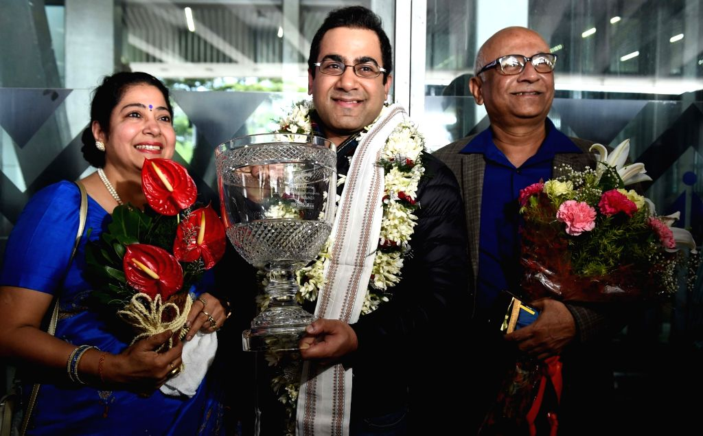 Indian billiards player Sourav Kothari being received by his parents at Netaji Subhas Chandra Bose International Airport (NSCBI) in Kolkata on Nov. 1, 2018. Sourav Kothari defeated Peter ...