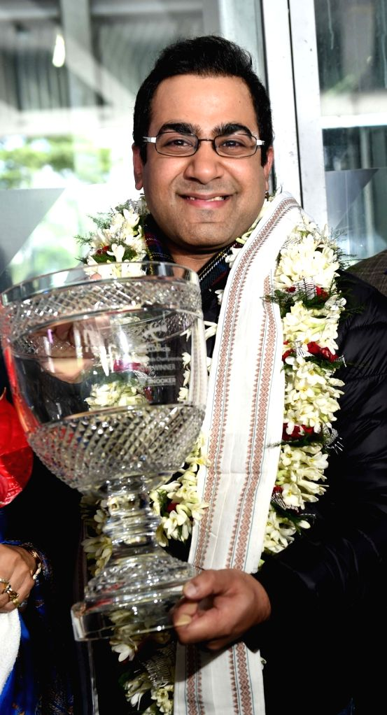 Indian billiards player Sourav Kothari with the 2018 WBL World Billiards Championship trophy at Netaji Subhas Chandra Bose International Airport (NSCBI) in Kolkata on Nov. 1, 2018. Sourav ...
