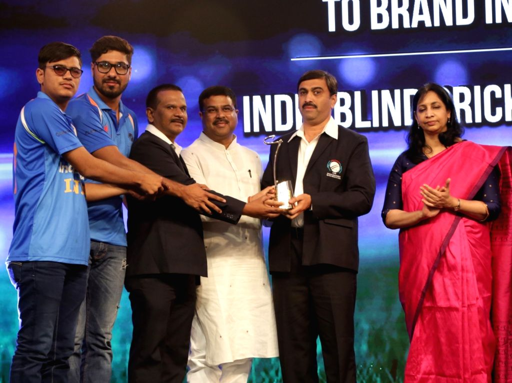 """Indian Blind Cricket Team receives """"Outstanding Contribution to Brand India"""" award from Union Minister Dharmendra Pradhan at the India Business er Awards in New Delhi on ... - Dharmendra Pradhan"""