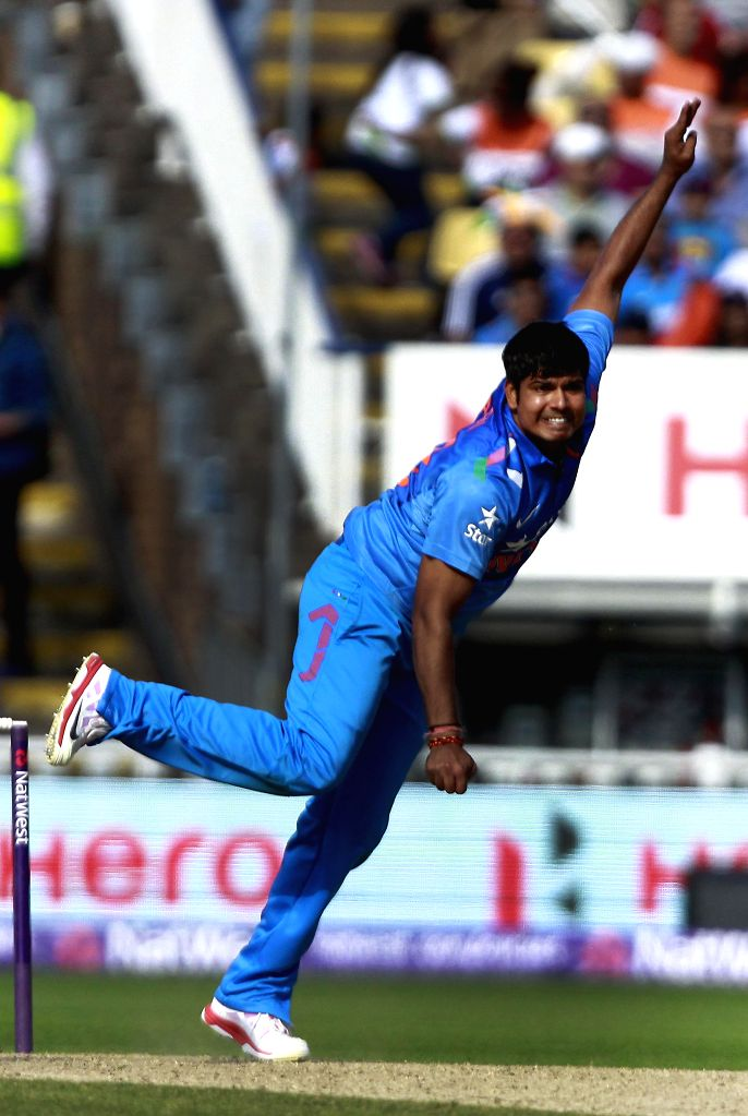 Indian bowler Karn Sharma in action during a T20 match between India and England at Edgbaston, Birmingham, England on Sept 7, 2014. - Karn Sharma