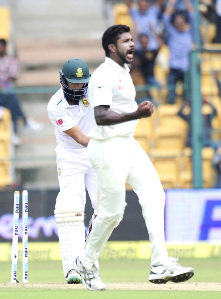 Indian bowler Varun Aaron celebrates fall of a wicket during the first day of the second test match between India and South Africa at M Chinnaswamy Stadium in Bengaluru, on Nov 14, 2015. - Varun Aaron