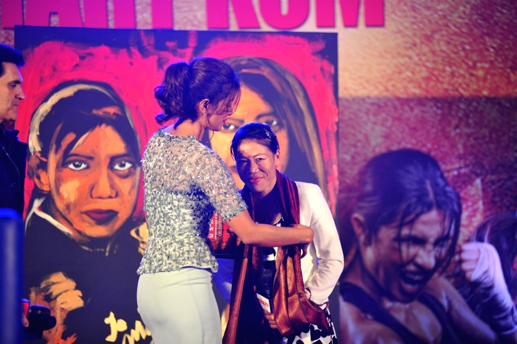 Indian boxer Mary Kom and actor Priyanka Chopra at music event of film Mary Kom in Mumbai on August 13, 2014. - Priyanka Chopra and Mary Kom