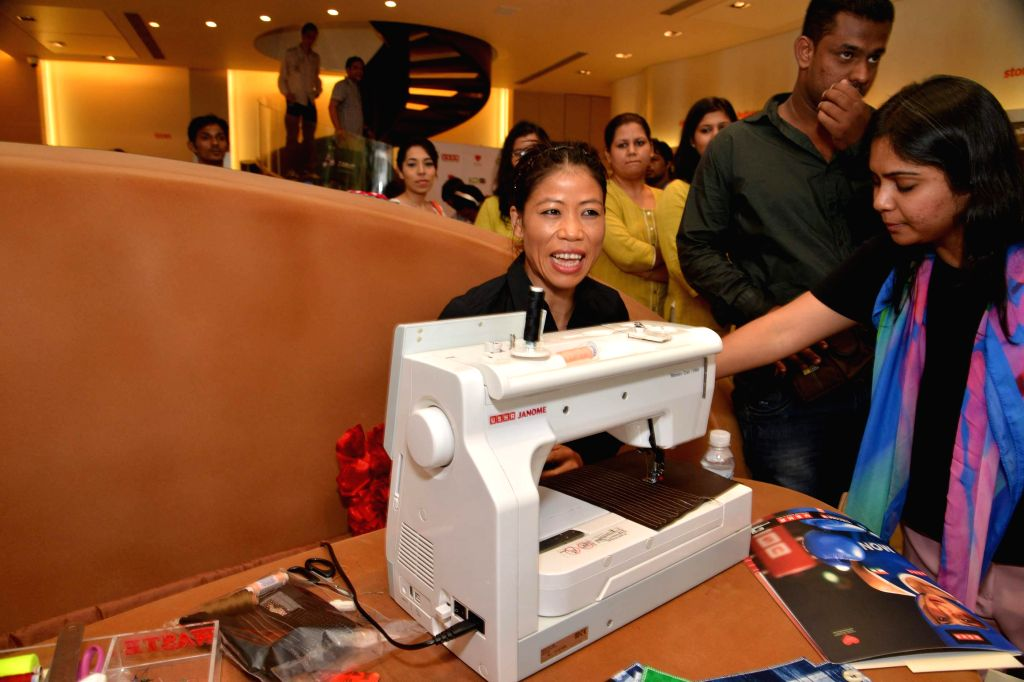 Indian boxer Mary Kom during a celebration on Women Empowerment organized by consumer durables company Usha International, in Mumbai, on August 13, 2014.