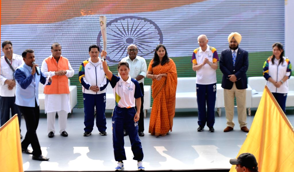Indian boxer MC Mary Kom holds the torch of the 18th Asian Games Jakarta-Palembang 2018 as the torch relay commenced from Major Dhyanchand National Stadium, in New Delhi on July 15, 2018. - Mary Kom