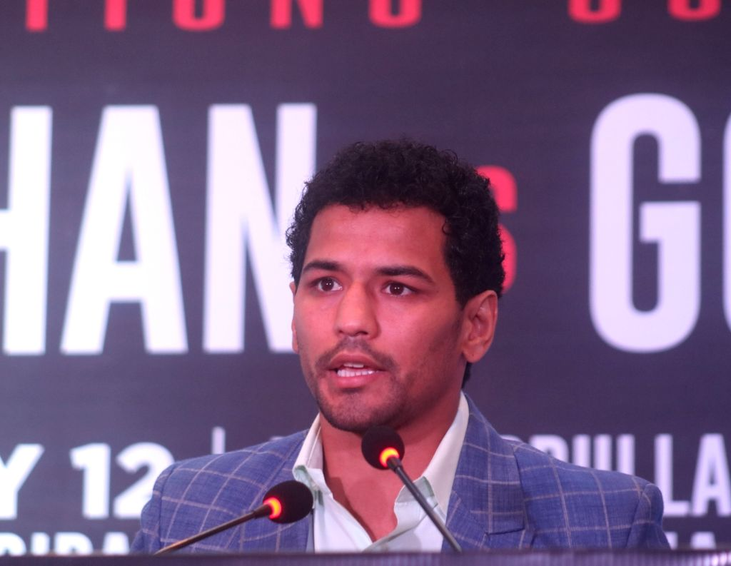 Indian boxer Neeraj Goyat addresses a press conference ahead of a face off against Pakistani boxer Amir Khan at the World Boxing Championship that will take place on July 12, 2019 at the ... - Khan