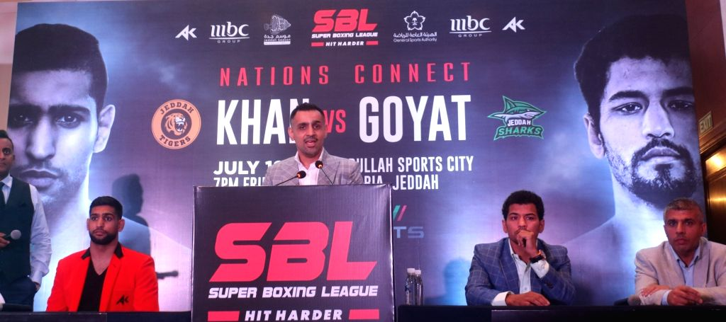 Indian boxer Neeraj Goyat and Pakistani boxer Amir Khan during a press conference ahead of their face off at the World Boxing Championship that will take place on July 12, 2019 at the King ... - Khan