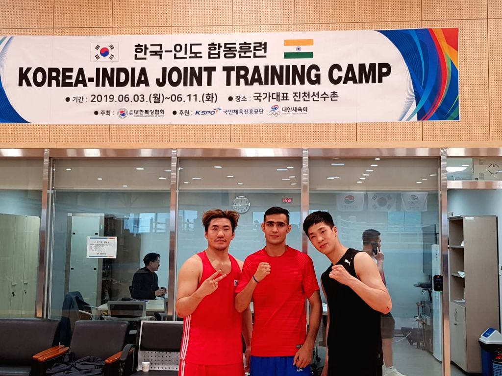 Indian boxer Sachin Siwach with Korean boxers during a training session ahead of the World Championships later in the year, during their joint training session in Incheon, Korea on June 7, ...