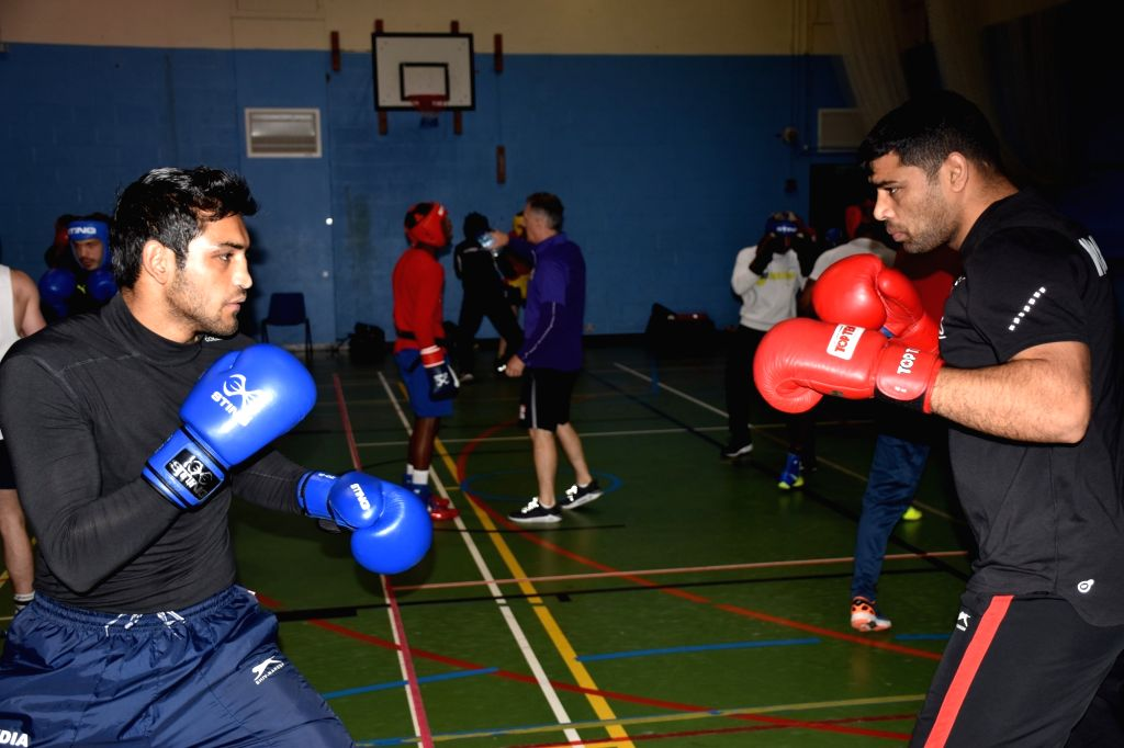 Indian boxers Ashish and Satish Kumar in action during a training session ahead of the World Championships later in the year, in Ireland's Belfast on June 8, 2019. With a packed schedule ... - Satish Kumar
