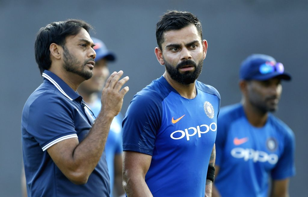 Indian captain Virat Kohli and chief Indian selector MK Prasad in action during a practice session ahead of the 1st T20I match against Australia at ACA-VDCA Cricket Stadium in Visakhapatnam ... - Virat Kohli