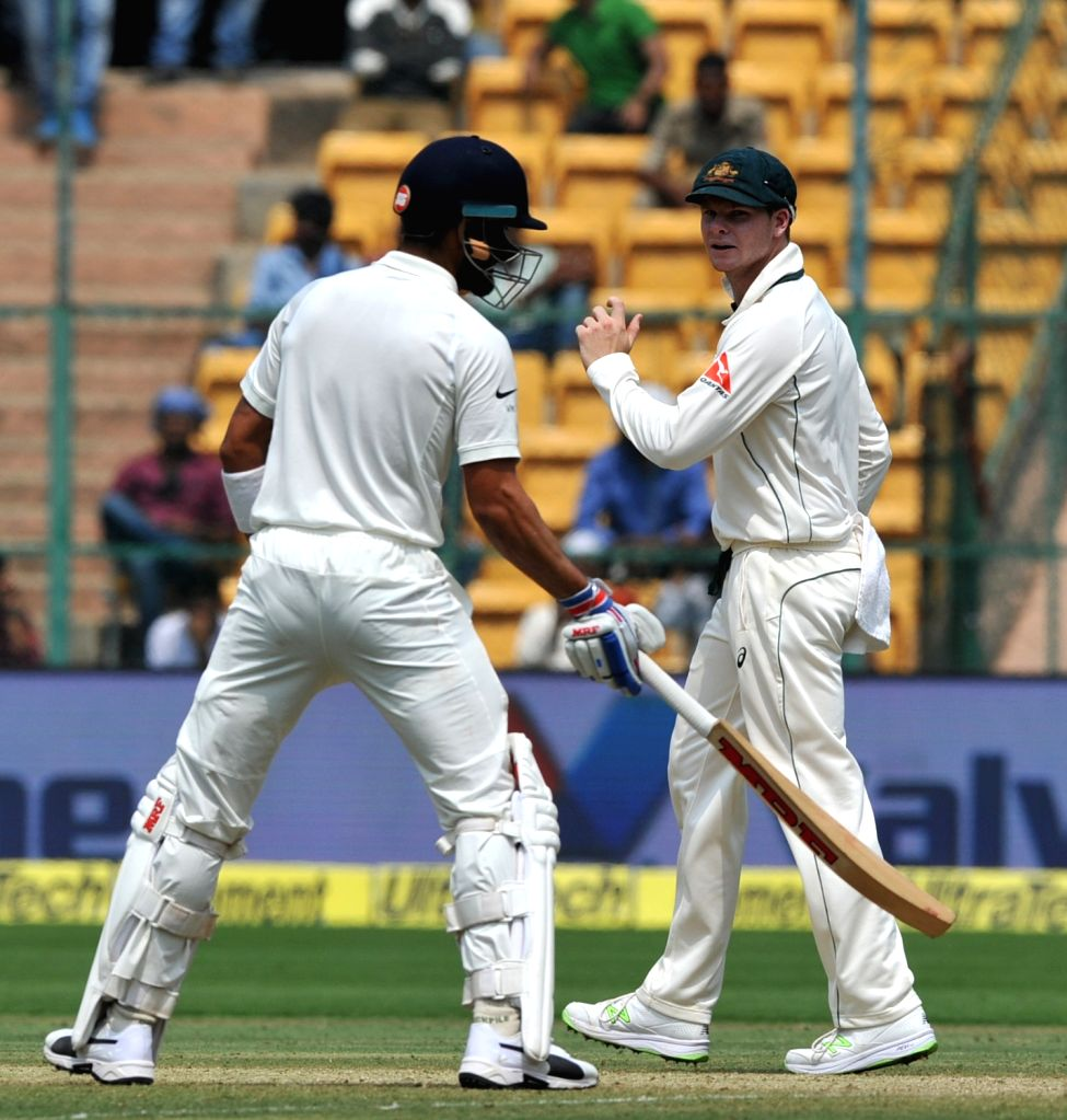 Indian captain Virat Kohli and his Australian counterpart Steven Smith during the third day of the second test match between India and Australia at M. Chinnaswamy Stadium in Bengaluru on ... - Virat Kohli