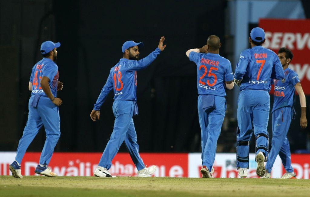 Indian captain Virat Kohli celebrates fall of David Warner's wicket during the second T20 match between India and Australia at Barsapara Cricket Stadium in Guwahati on Oct 10, 2017. - Virat Kohli