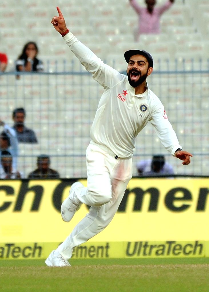 Indian captain Virat Kohli celebrates fall of a wicket on Day 2 of the Second Test Match between India and New Zealand at Eden Gardens in Kolkata on Oct 1, 2016. - Virat Kohli