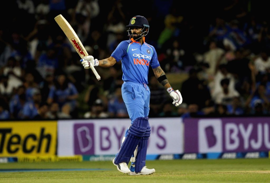 Indian captain Virat Kohli celebrates his half-century during the 3rd ODI match between India and New Zealand at Bay Oval in Mount Maunganui, Tauranga, New Zealand on Jan 28, 2019. (Photo Surjeet Yadav/IANS) - Virat Kohli and Surjeet Yadav
