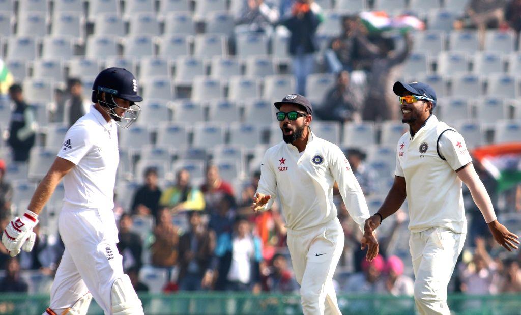 Indian Captain Virat Kohli celebrates the dismissal of Joe Root of England during day 1 of the third test match between India and England held at the Punjab Cricket Association IS Bindra ... - Virat Kohli