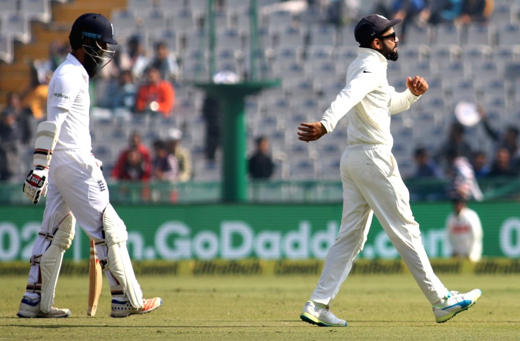 Indian Captain Virat Kohli celebrates the dismissal of Moeen Ali of England during day 1 of the third test match between India and England held at the Punjab Cricket Association IS Bindra ... - Virat Kohli