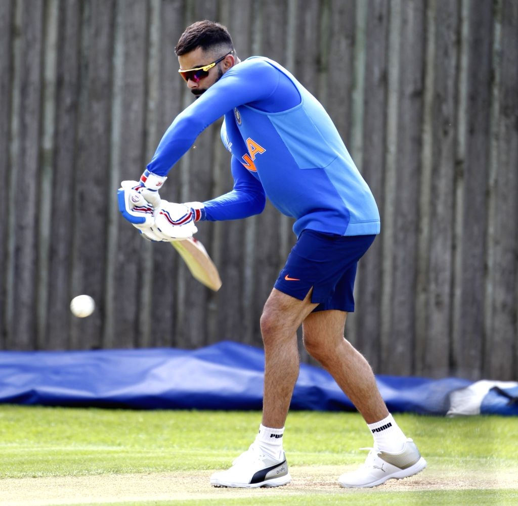 Indian captain Virat Kohli during a practice session ahead of a World Cup 2019 match against Afghanistan at the Hampshire Bowl in Southampton, England on June 20, 2019. (Photo: Surjeet Yadav/IANS) - Virat Kohli and Surjeet Yadav