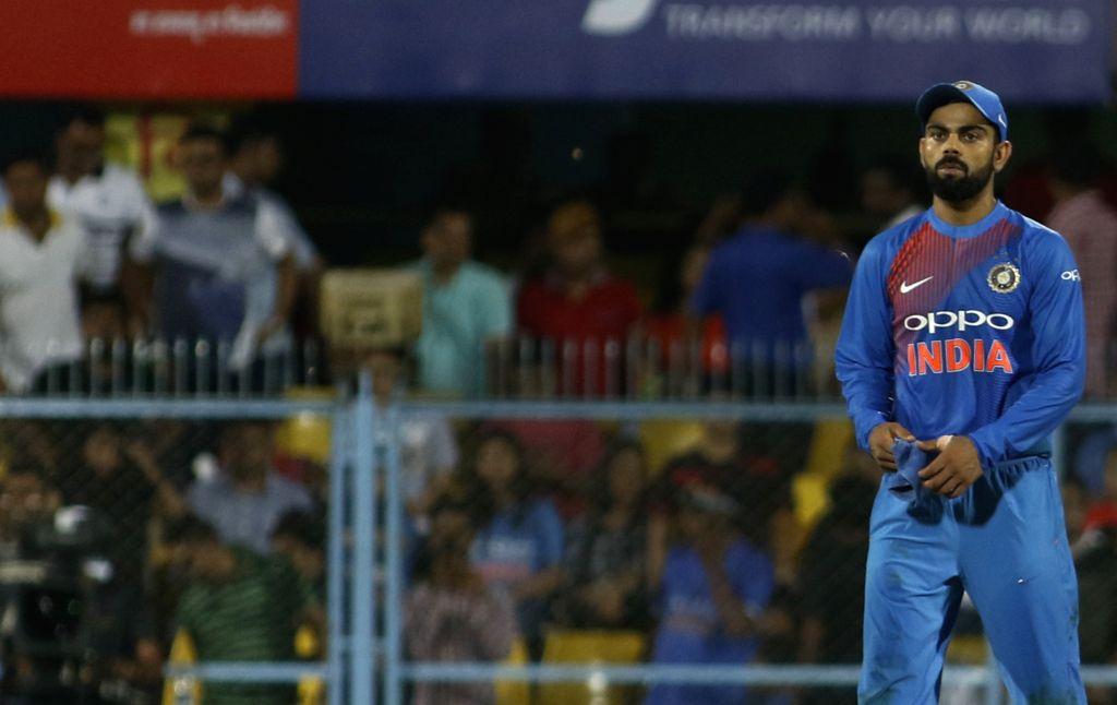 Indian captain Virat Kohli reacts after Australia won the second T20 match between India and Australia at Barsapara Cricket Stadium in Guwahati on Oct 10, 2017. - Virat Kohli