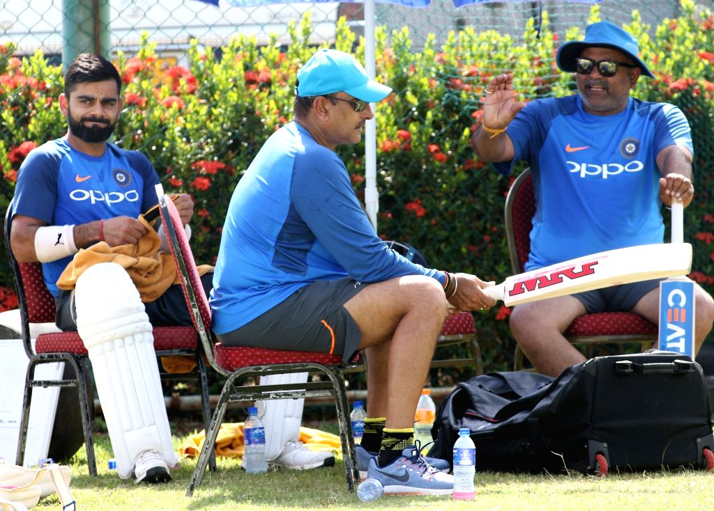 Indian captain Virat Kohli with head coach Ravi Shastri and bowling coach Bharat Arun during a practice session at Galle International Stadium in Galle, Sri Lanka on July 25, 2017. - Virat Kohli