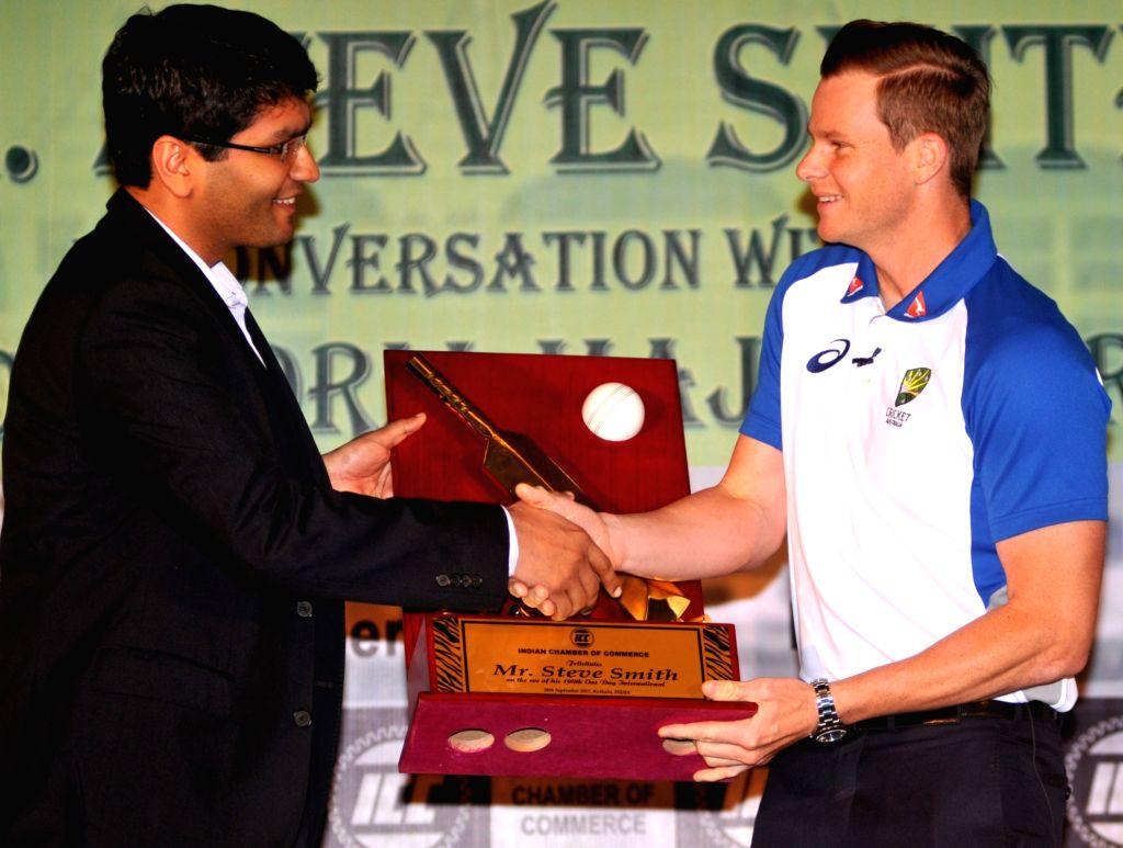 Indian Chamber of Commerce President Shashwat Goenka felicitates Australia cricket captain Steve Smith as he prepares to play his 100th one-day international for Australia, in Kolkata on ... - Steve Smith and Shashwat Goenka