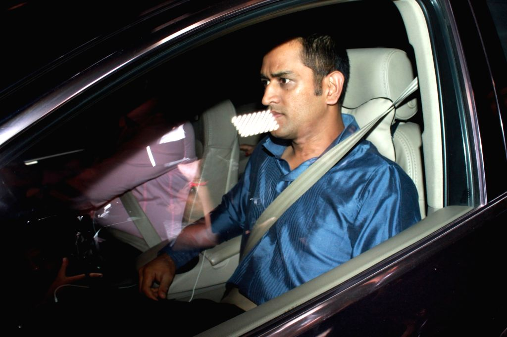Indian cricket captain MS Dhoni arrives to attend the wedding reception of cricketer Harbhajan Singh and actress Geeta Basra in New Delhi, on Nov 1, 2015. - MS Dhoni