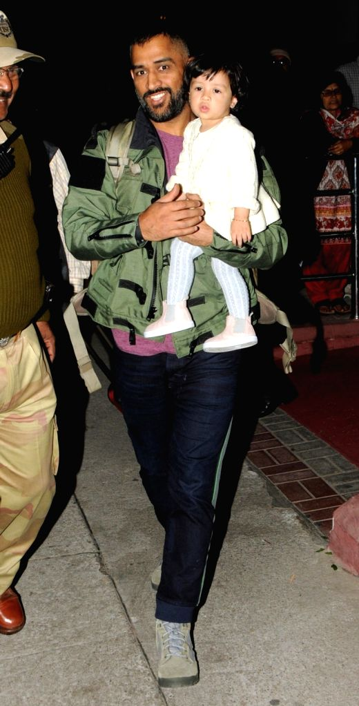Indian Cricket captain MS Dhoni with his daughter  Ziva Dhoni at Birsa Munda Airport in Ranchi on Nov 28, 2016. - MS Dhoni and Birsa Munda Airport