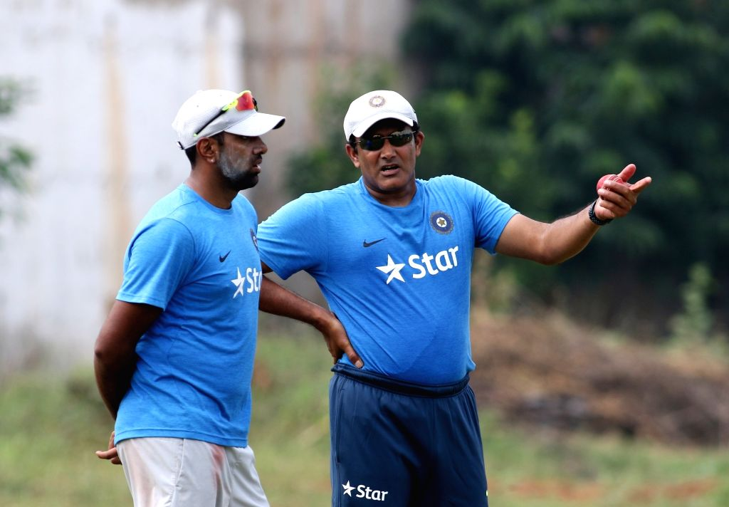 Indian cricket coach Anil Kumble interacts with R Ashwin during a practice session in Visakhapatnam on Nov 16, 2016.