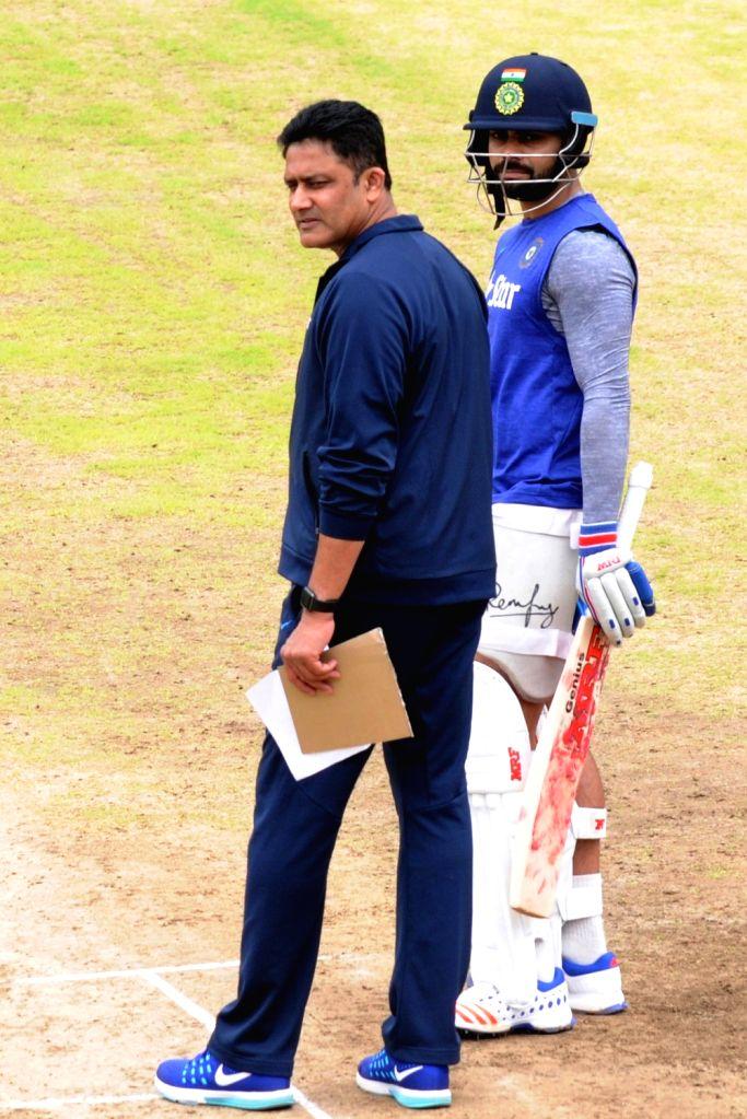 Indian cricket team head coach Anil Kumble and Virat Kohli during a preparatory camp ahead of  West Indies tour at National Cricket Academy at Chinnaswamy Stadium, in Bengaluru on July 1, ... - Virat Kohli