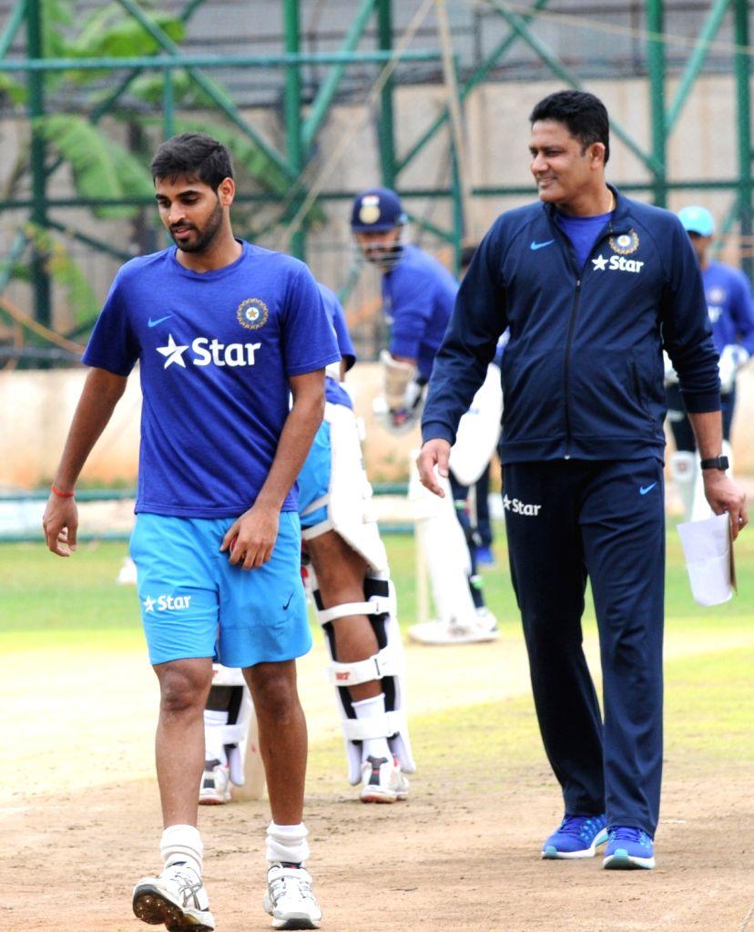 Indian cricket team head coach Anil Kumble and Bhuvneshwar Kumar during a preparatory camp ahead of  West Indies tour at National Cricket Academy at Chinnaswamy Stadium, in Bengaluru on ... - Bhuvneshwar Kumar