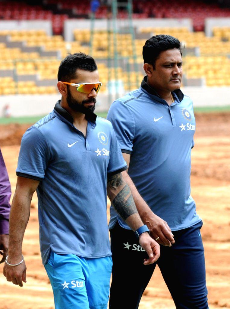 Indian cricket team head coach Anil Kumble and Virat Kohli during a preparatory camp ahead of  West Indies tour at National Cricket Academy at Chinnaswamy Stadium, in Bengaluru on July 4, ... - Virat Kohli