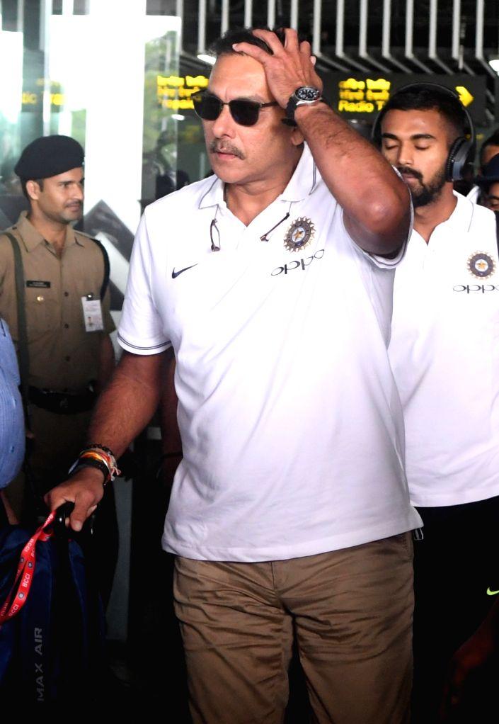 Indian cricket team head coach Ravi Shastri arrives at Netaji Subhas Chandra Bose International Airport in Kolkata on Sept 18, 2017.